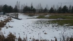 Монах в пруду